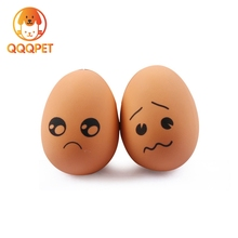 Factory price egg shaped natural sound squeaker rubber pet toys