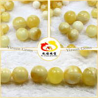 yellow and white color striped natural amber