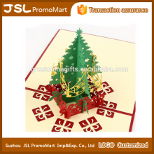 Handmade paper craft 3D greeting Christmas card shaped in Christmas tree for Christmas day