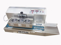Induction Sealer Plastic Food Containers Sealing Machine Aluminum Foil is used to Seal the Cap