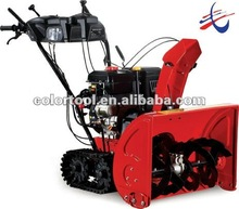 Two-stage track snow thrower