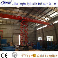 Four-wheel mobile scissor lift with handrail