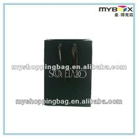 green paper bag with logo and satin handles