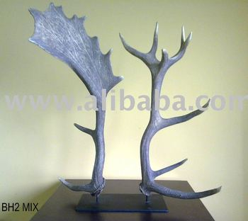deer and fallow horn couple on iron stand