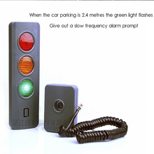 Ultrasonic parking space indicator with garage red green light