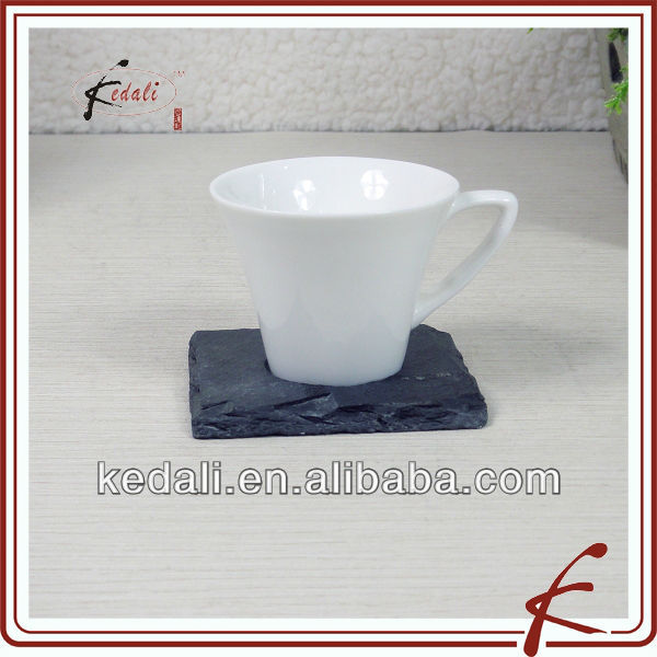 white ceramic square tea cup and stone saucer