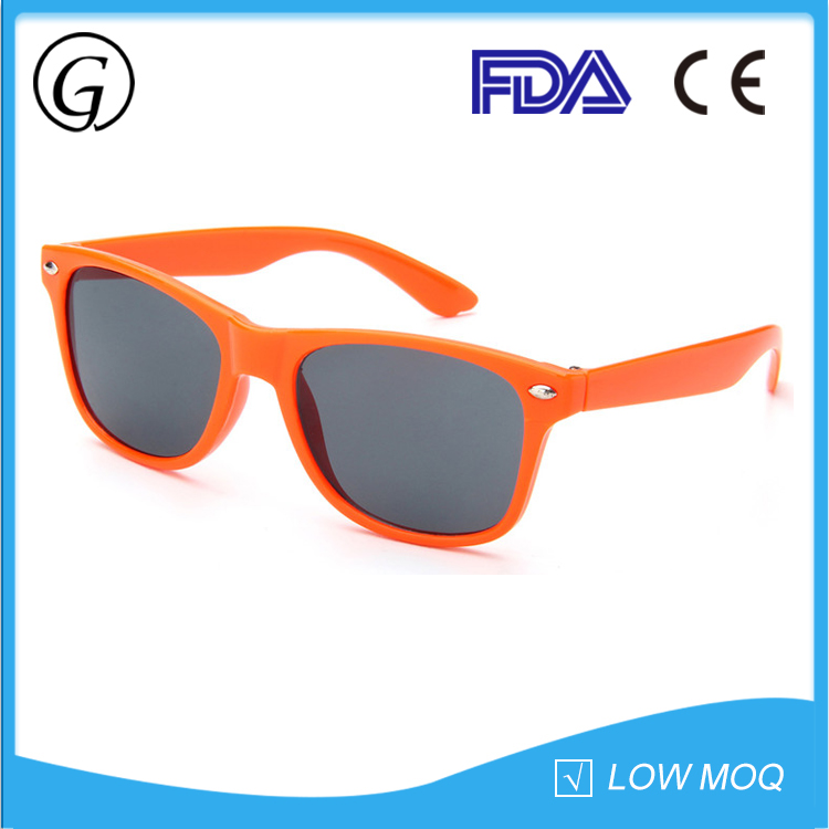 Cheap orange plastic frame children's sunglasses deflecting UV rays