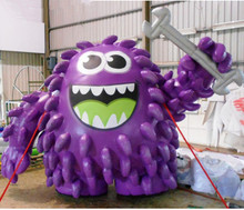 Giant inflatable purple monster mascot with wrench