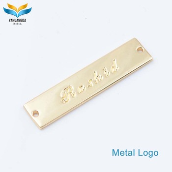 metal logo maker wholesale famous metal clothing/garment embossed brand logos label sew