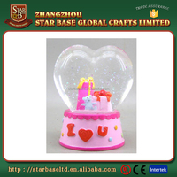 Heart shape glass ball wholesale resin cheap water globes