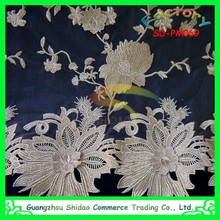 Tulle Lace Fabric is a thin plain weave sheer fabric made from polyester Embroidered with floral design gold lace fabric