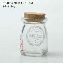 small clearly glass milk bottles with cork