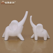 pure white jade imitation elephant in simple abstract design for promotion