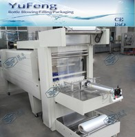 Plastic film shrink wrapping machine