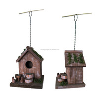 Wooden Wild Bird House In Garden