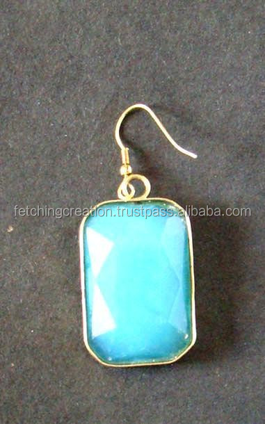 Sky blue single stone in golden frame earrings