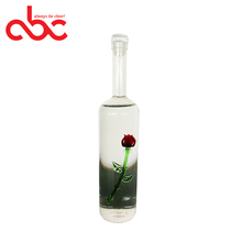 OEM / ODM Handmade Borosilicate Fancy Unique Shaped Glass Liquor Wine Bottle With Glass Red Rose For Decoration