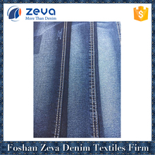 Good quality new design colored stock denim fabric cheap denim fabric for woman jeans