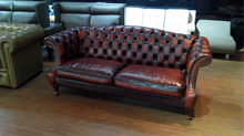 tufted curved leather sofa