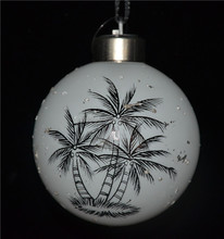 Glass christmas ball with led light with painted coconut tree on surface as beautiful christmas home decor from china market