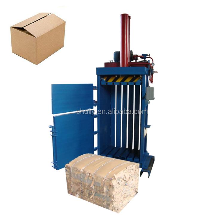 Hydraulic system baler for waste carton beverage bottles