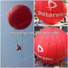 Huge inflatable manned balloon flying on sky