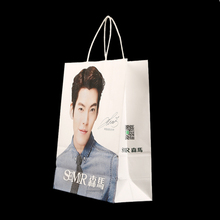 Wholesale fashion design paper bags with flat handle,luxury paper shopping bag