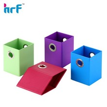 Folded paper pen holder with eyelet on both side