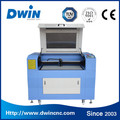 New year promotion price cnc laser cutting engraving machine for acrylic wood leather fabric MDF cnc co2 laser