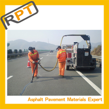 Professional sealant on road repair material
