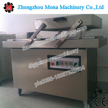 Automatic fish meat chicken pouch egg rice vacum packing machine vacuum sealing packaging machine