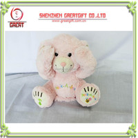 stock pink electronic laughing and singing plush rabbit toys
