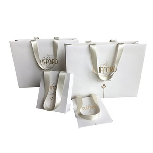 Strong Fashion Luxury Gift Shopping Packaging Custom Emboss Paper Bag With Ribbon Handles