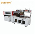 Automatic sealing and shrink packaging machine