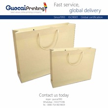 OEM Custom printing handmade shaped flat handle natural waterproof kraft paper bag