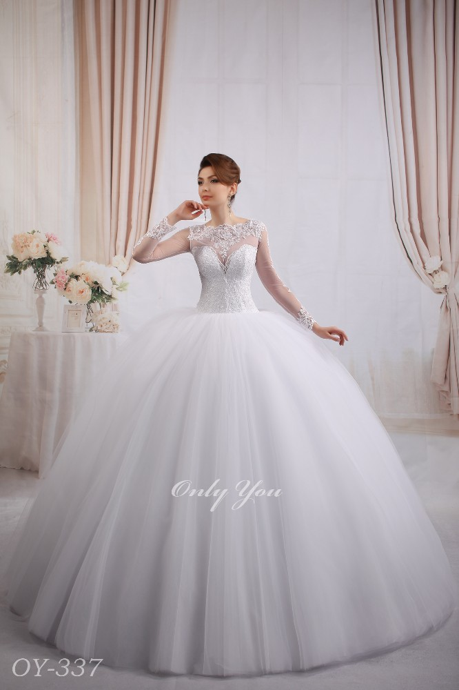 Very Full Skirt wedding dress 15 tulle layers Tail Beaded lace Long sleeves Closed back Pearl Buttons