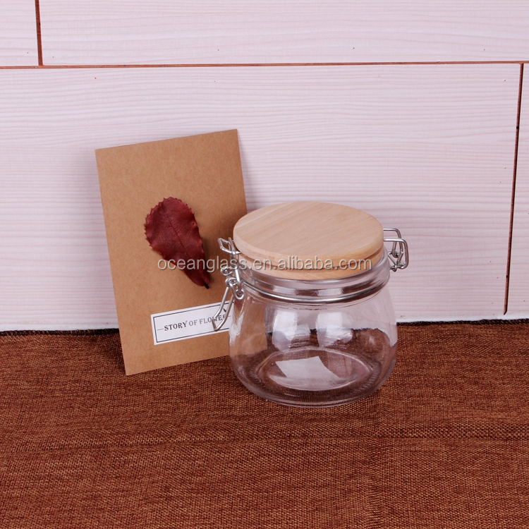 Wholesale 500ml metal clip top glass container / 17oz glass storage jar with wooden lid