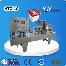 PLC controlled automatic milk cup filling and sealing machine for beverage production
