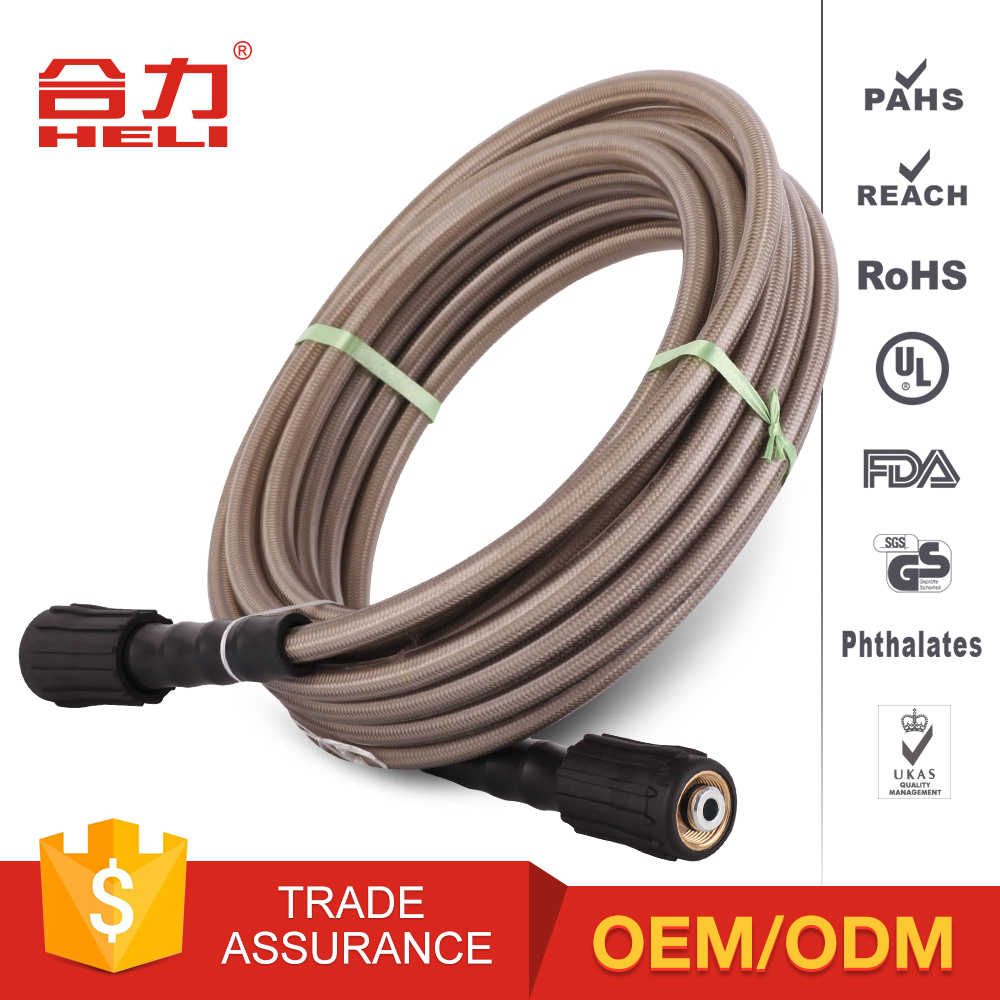 Multiple grey jet washing car wash hose with high pressure water spray