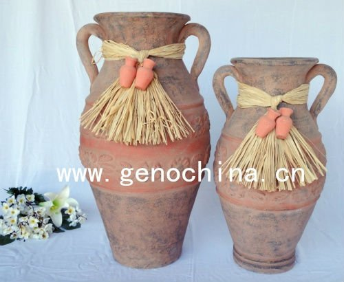 terracotta flower vase with straw and two small clay pots