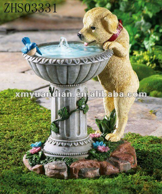 garden fountain with bird and dog drinking water