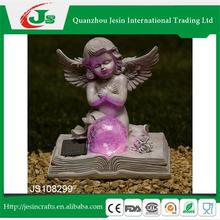 Resin angel kneeling Bible with solar ball decoration, for decorating the grave