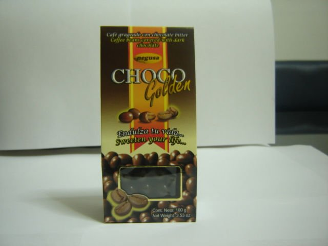 Coffee beans or dry orange covered with chocolate