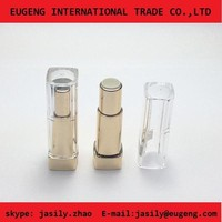 Gold color lipstick tube with clear cap