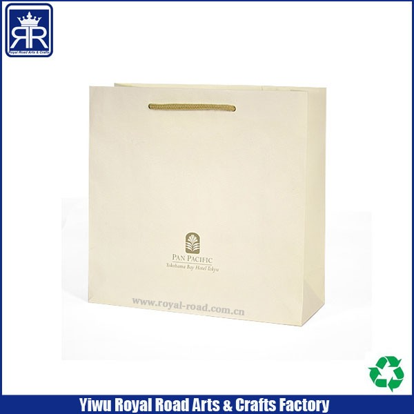 Luxury matte beige shopping paper bag with logo UV for clothing packaging