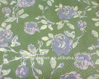 green color printed leather with flower pattern