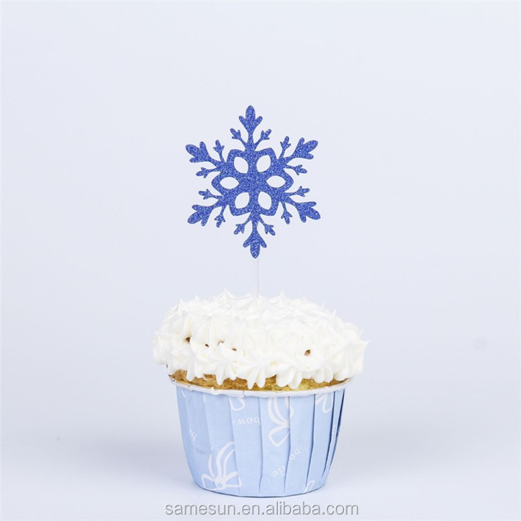 Colorful glittery paper snowflake cupcake toppers for cake decoration