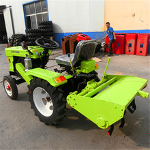 Chinese cheap mini farm tractor 12hp with tiller, plow, snow blade