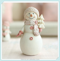 small resin snowman figurine in Christmas girl design