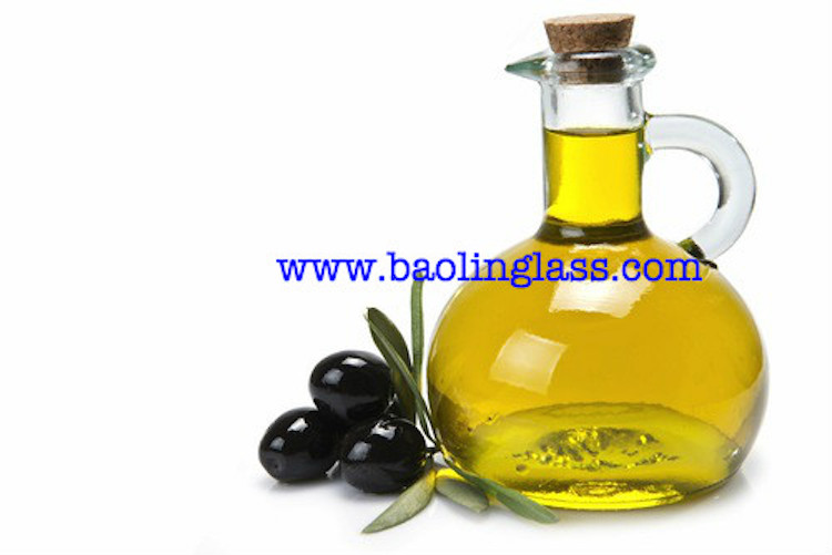 olive oil in glass bottle with cork
